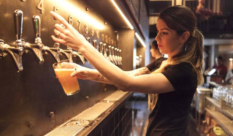 Bartender working the taps and brewery POS